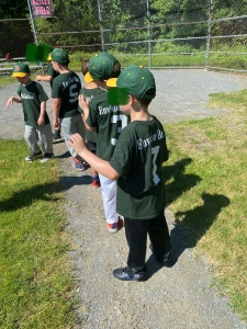 Players lined up at home plate after a game.