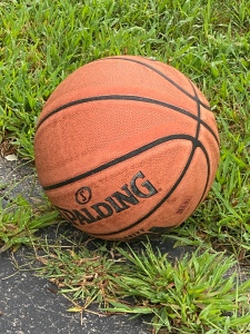 A basketball laying on the ground.