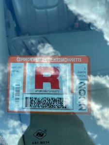 A rejection sticker on a car that failed inspection.